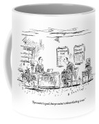 A Man Behind A Desk Gives The Man Sitting Coffee Mug
