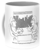 A Man Behind A Desk Speaks To Another Man In An Coffee Mug