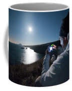 A Man Captures The Full Moon Coffee Mug