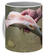A Man Cleans A Lake Trout Fish Coffee Mug