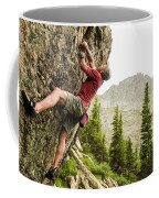 A Man Clinging To Rock Face In The Coffee Mug