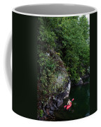 A Man Floats Along In A Kayak Coffee Mug