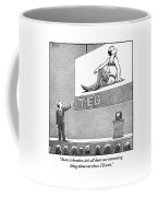 A Man Giving A Ted Presentation Points To An Coffee Mug