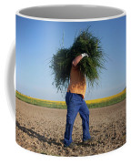 A Man Harvests Sedge To Be Used Coffee Mug
