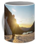 A Man Hiking On Snowfield At Sunrise Coffee Mug