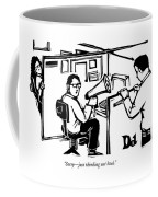 A Man Is Seated In His Cubicle With A Megaphone Coffee Mug