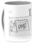 A Man Is Seen Swinging A Group Of Kids Like A Set Coffee Mug