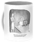A Man Is Sitting At A Desk Looking At A Computer Coffee Mug