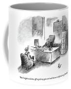 A Man Is Sitting Behind A Desk Talking To A Man Coffee Mug