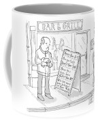 A Man Outside A Bar Checks His Watch And Reads Coffee Mug
