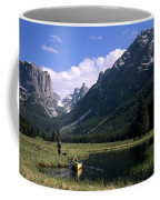 A Man Pulls His Canoe Up A River Valley Coffee Mug