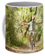 A Man Rides A Bicycle Coffee Mug