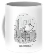 A Man Sits At A Desk Coffee Mug