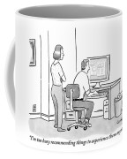 A Man Sits In Front Of His Computer. His Wife Or Coffee Mug