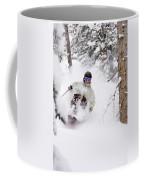 A Man Skiing Powder In The Trees Coffee Mug