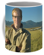 A Man Stands In A Field Next Coffee Mug