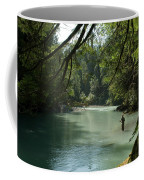 A Man Stands In A River Wearing Waders Coffee Mug