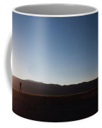 A Man Stands On A Wall In The Salar De Coffee Mug