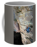 A Man Tackles An Overhanging Sandstone Coffee Mug