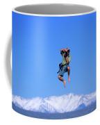 A Man Takes A Photo While Jumping Coffee Mug