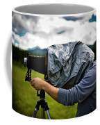 A Man Takes A Photograph With His Large Coffee Mug
