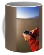 A Man Using A Gps Device At Sunset Coffee Mug