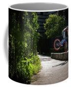 A Man With A Bike Standing On The Front Coffee Mug