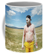 A Mans Face Covered In Clay Mud Coffee Mug