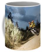 A Mountain Biker Rides A Trail Coffee Mug