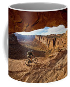 A Mountain Biker Rides By On Slickrock Coffee Mug