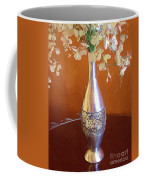A Painting Silver Vase On Table Coffee Mug