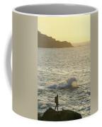 A Person Hiking On Rocky Shore Coffee Mug