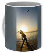 A Person Practices Yoga At The Waters Coffee Mug