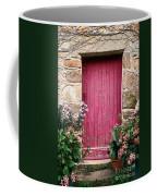 A Pink Door Coffee Mug by Olivier Le Queinec