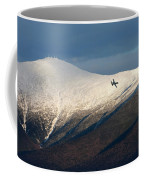 A Plane Flies In The Distance Over Mt Coffee Mug