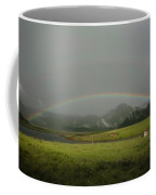 A Rainbow Over A Valley With A Small Coffee Mug