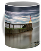 A Red And White Striped Lighthouse Coffee Mug