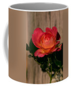A Red Rosr Against A Weathered  Wood Background Coffee Mug