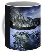 A River Flowing Through The Snowy Coffee Mug