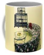 A Round Couch And A Birdcage Coffee Mug