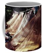 A Row Of Mosquito Netting Over Sleeping Coffee Mug