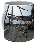 A Sailor Fires An M-240b Machine Gun Coffee Mug by Stocktrek Images