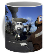 A Sailor Signals To Pilots Of An E-2c Coffee Mug