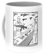 A Sales Clerk Shows Off An Automatic Weapon Coffee Mug