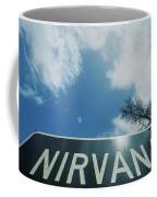 A Sign That Reads Nirvana Coffee Mug