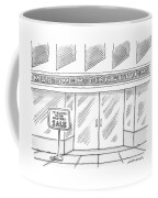 A Single Building Is Seen With A Sign Coffee Mug