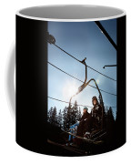 A Skier And Snowboarder Share The Chair Coffee Mug