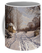 A Sleigh Ride Through A Winter Landscape Coffee Mug by Peder Monsted
