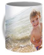A Smiling Young Boy Enjoys A Sunny Coffee Mug
