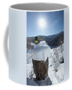 A Snowboarder Jumps Off A Cliff Coffee Mug